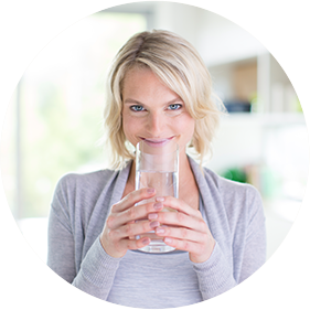 Woman Drinking Fiber Supplement